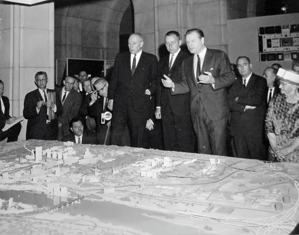 Erastus Corning (left) appears dismayed by Nelson Rockefeller's plans for Albany. Malcolm Wilson stands between the two men. NYS Archives.