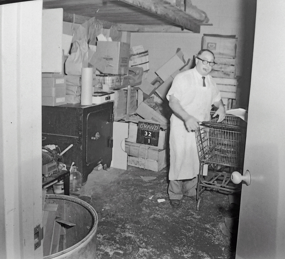 Employee at the Western House of Beef, 32 Grand Street. NYS Archives.
