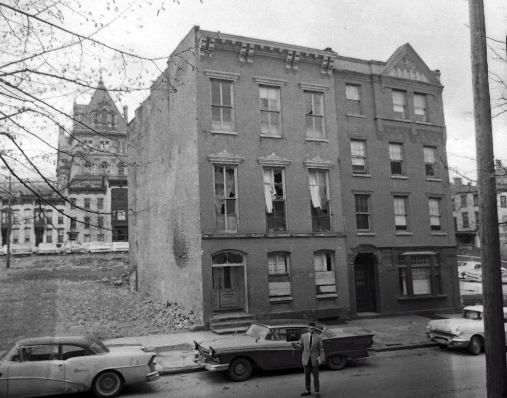 59 Lancaster Street, one of Mrs. Carlson's boarding houses not long before demolition, May 2963.. NYS Archives.