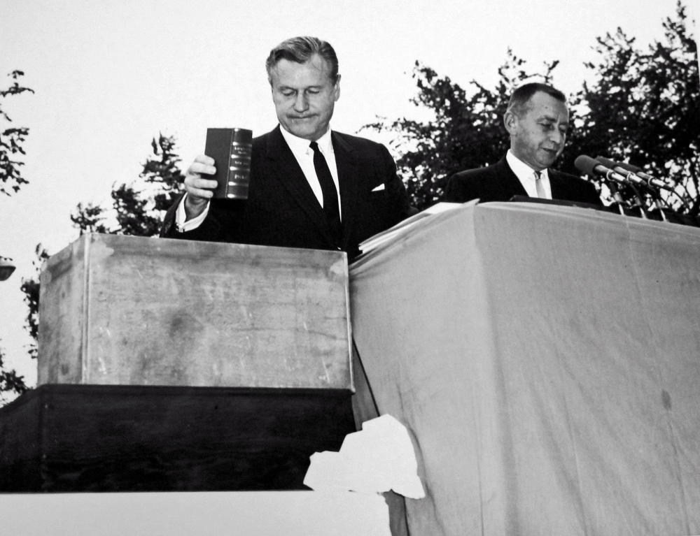 Lt. Gov. Malcolm Wilson and Gov. Rockefeller fill the document box before placing it in the cornerstone. NYS Archives.