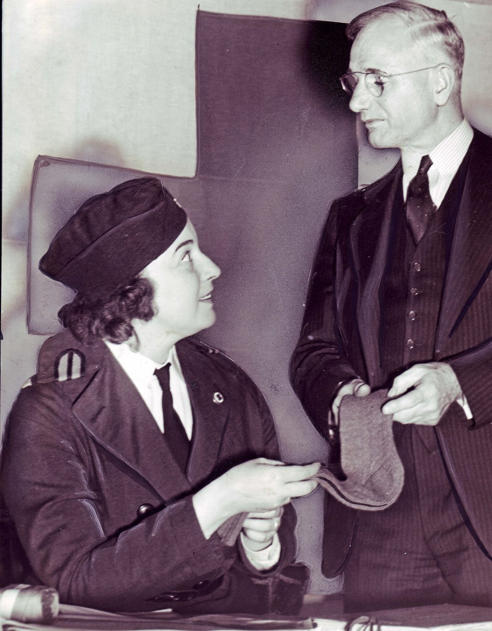 Elise once again makes the frontpage, this time as a lieutenant in the Albany County Chapter of the American Red Cross. She shows Earl Wagner socks knitted for British soldiers. Used by permission of Times Union.