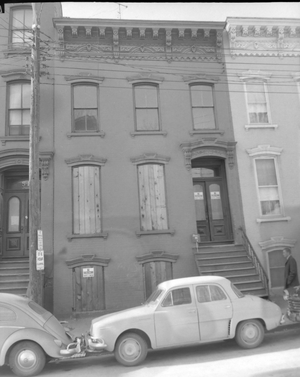 Two doors down from Elise Levine's home, 96 Jay Street is boarded up, October 1962. The property was vacant even before State appropriated it. NYS Archives.