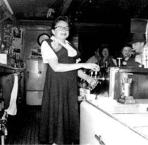 Rose Levine behind the bar at Dinty's Tavern. Courtesy Barry Levine.