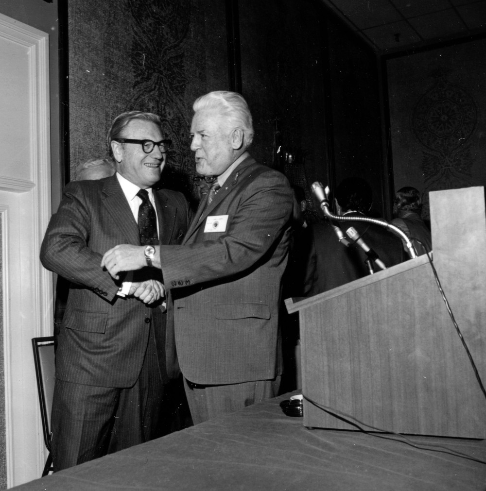 Nelson Rockefeller shakes the hand of Peter J. Brennan at the annual convention of the New York State Building and Construction Trades Council in Rochester, August 6, 1970. By permission of the Rockefeller Archives Center.