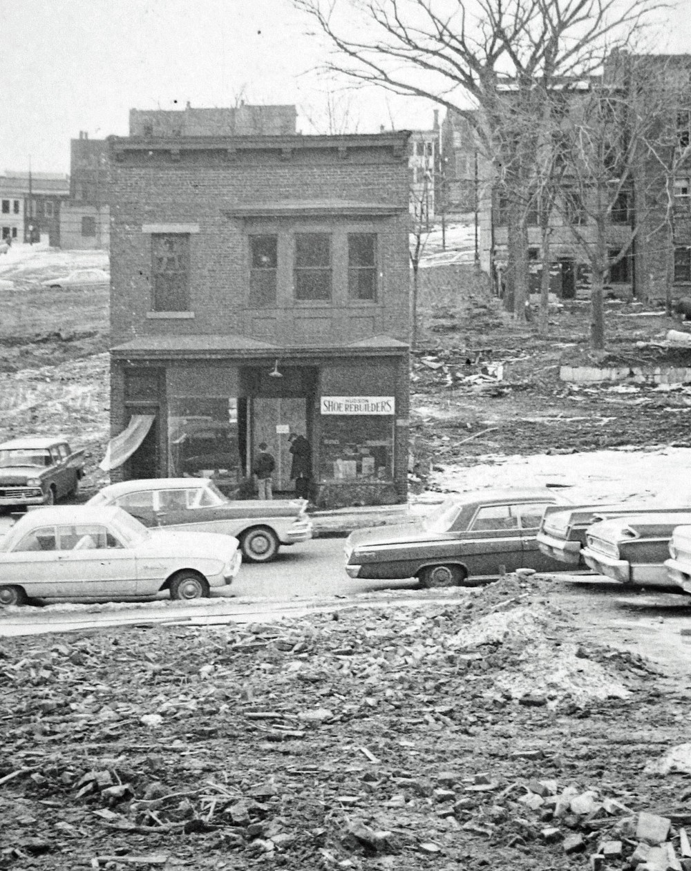 The block has been cleared save for 162 Hudson, February 1964. Albany Institute.