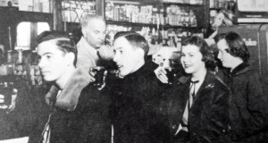 High school students from Cathedral Academy at the soda fountain. Ken Hunter is behind the counter. Courtesy Mary Jane Hunter Kretzler.