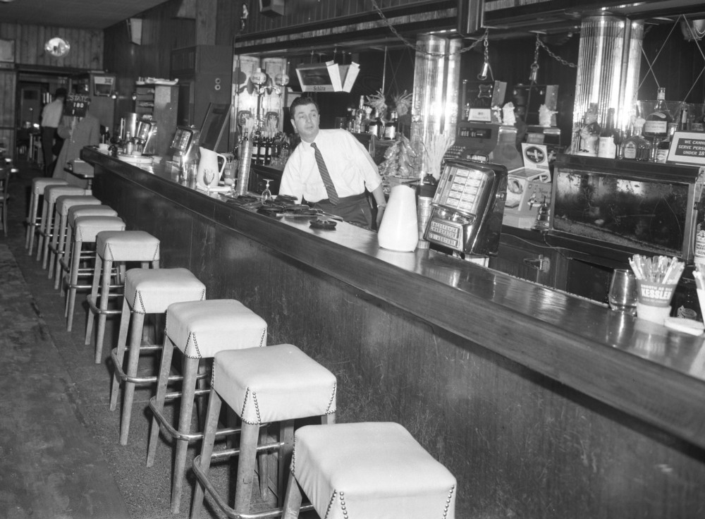 Marv Sherman at the bar of the old Ambassador, March 1963. NYS Archives.