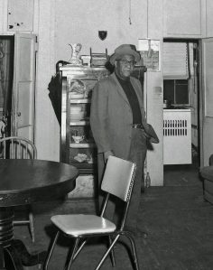 Mr. Strawn inside his 29 Grand Street apartment. NYS Archives.