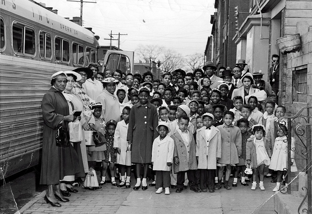 Elder Jack Johnson stands outside St. John's COGIC with some of the families he helped bring to Albany. Courtesy Clarence Samuel Johnson.