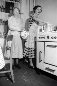 """Elinor with her mother Nora. Leo wrote on the back of the photo: """"Nanny and Elinor cooking the Christmas dinner 1946/47. The coffee was good-good."""" Courtesy Mike Mullen."""